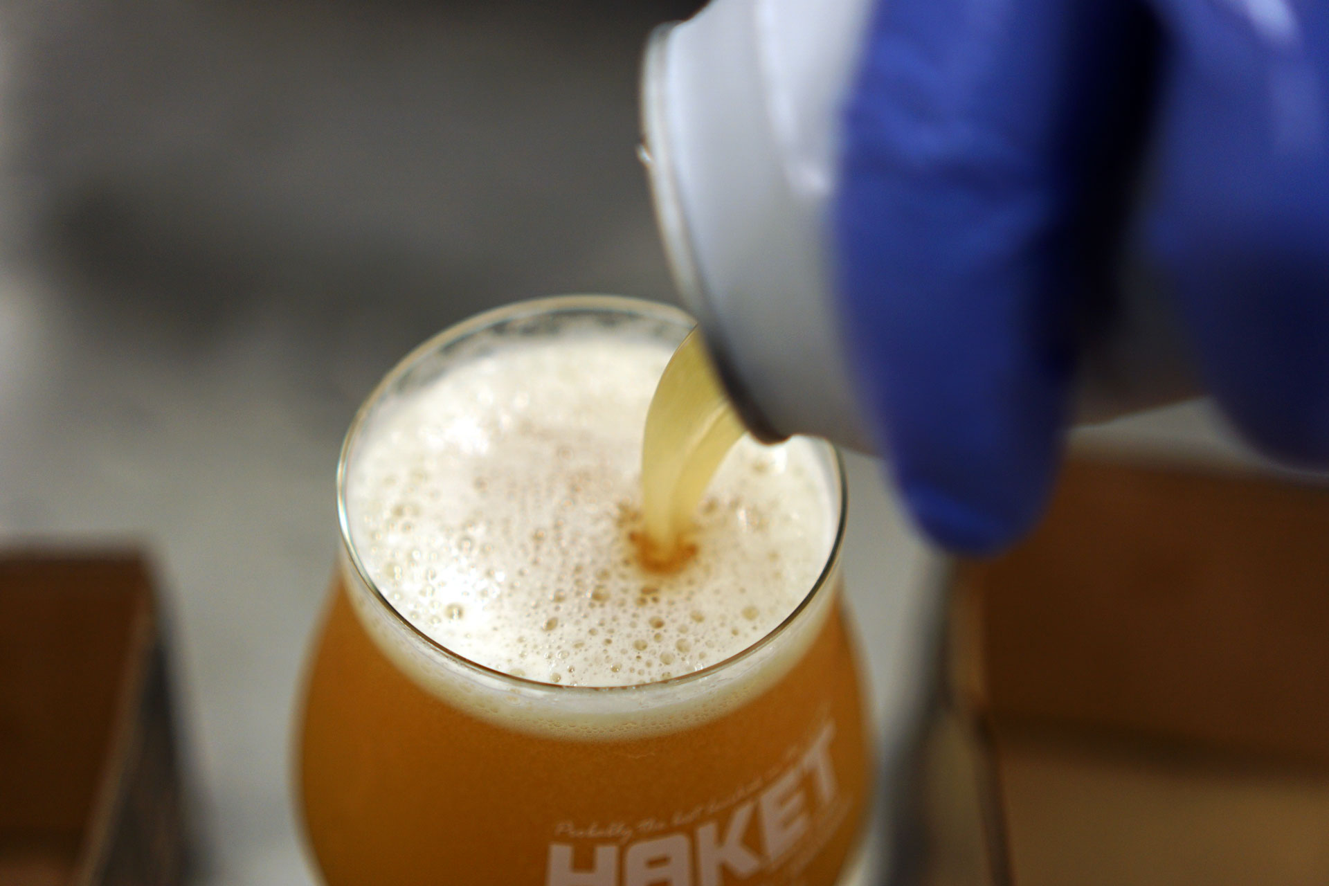 Pouring a can of beer for a tasting in the Beerbliotek Craft Brewery in Sweden.