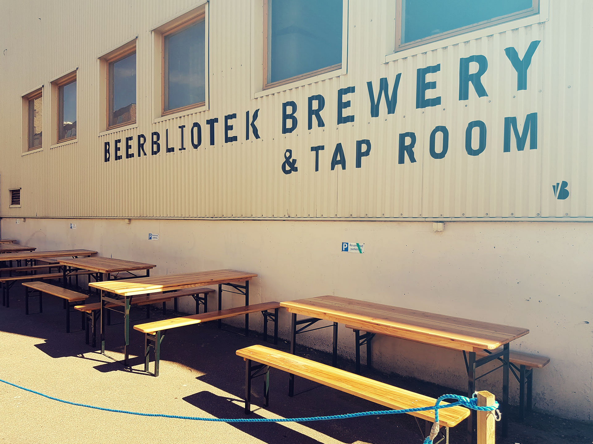 Beerbliotek Brewery & Tap Room outside, with signage, tables and chairs, just before an event.