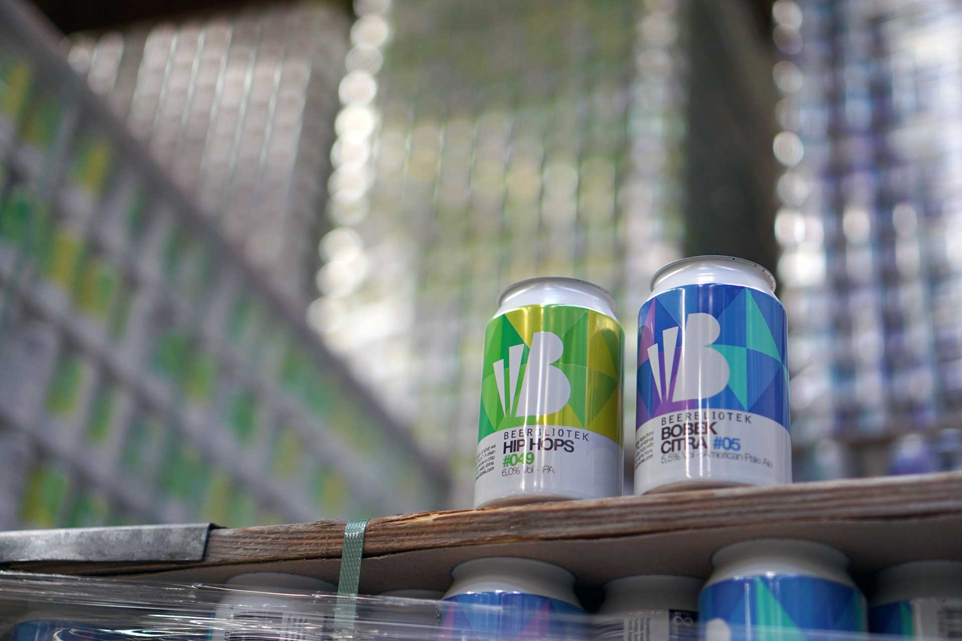 """Two empty cans of Beerbliotek Beers, """"Hip Hops"""" IPA and """"Bobek Citra"""" American Pale Ale."""