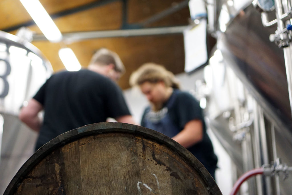 A rum barrel being filled with Oat Stout at the Beerbliotek Brewery.