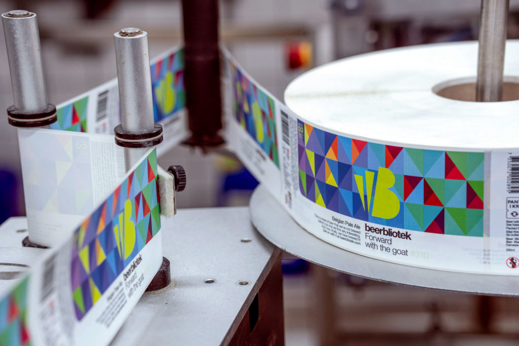 Labels of Forward with the goat, a Belgian Pale Ale, on packaging day, brewed at Swedish Craft Brewery Beerbliotek.