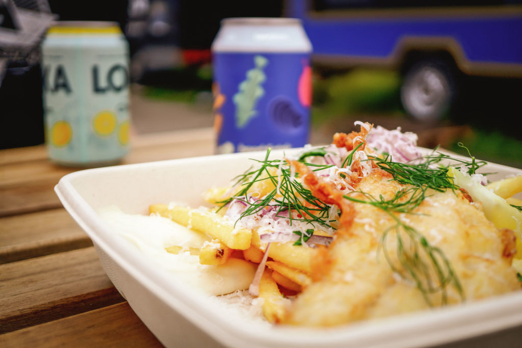 Fish and Chips, from Hasselssons, a pop up Seafood restaurant food truck in Skähamn. Next to sits a can of Hasselssons Li'l Pils, brewed by Swedish Craft Beer Beerbliotek from Gothenburg, Sweden.