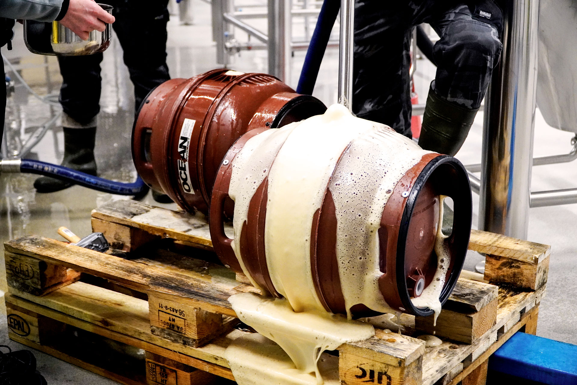 Staff filling a barrel with Malt Beverage, an Amber Lager, brewed by Swedish Craft Brewery Beerbliotek.