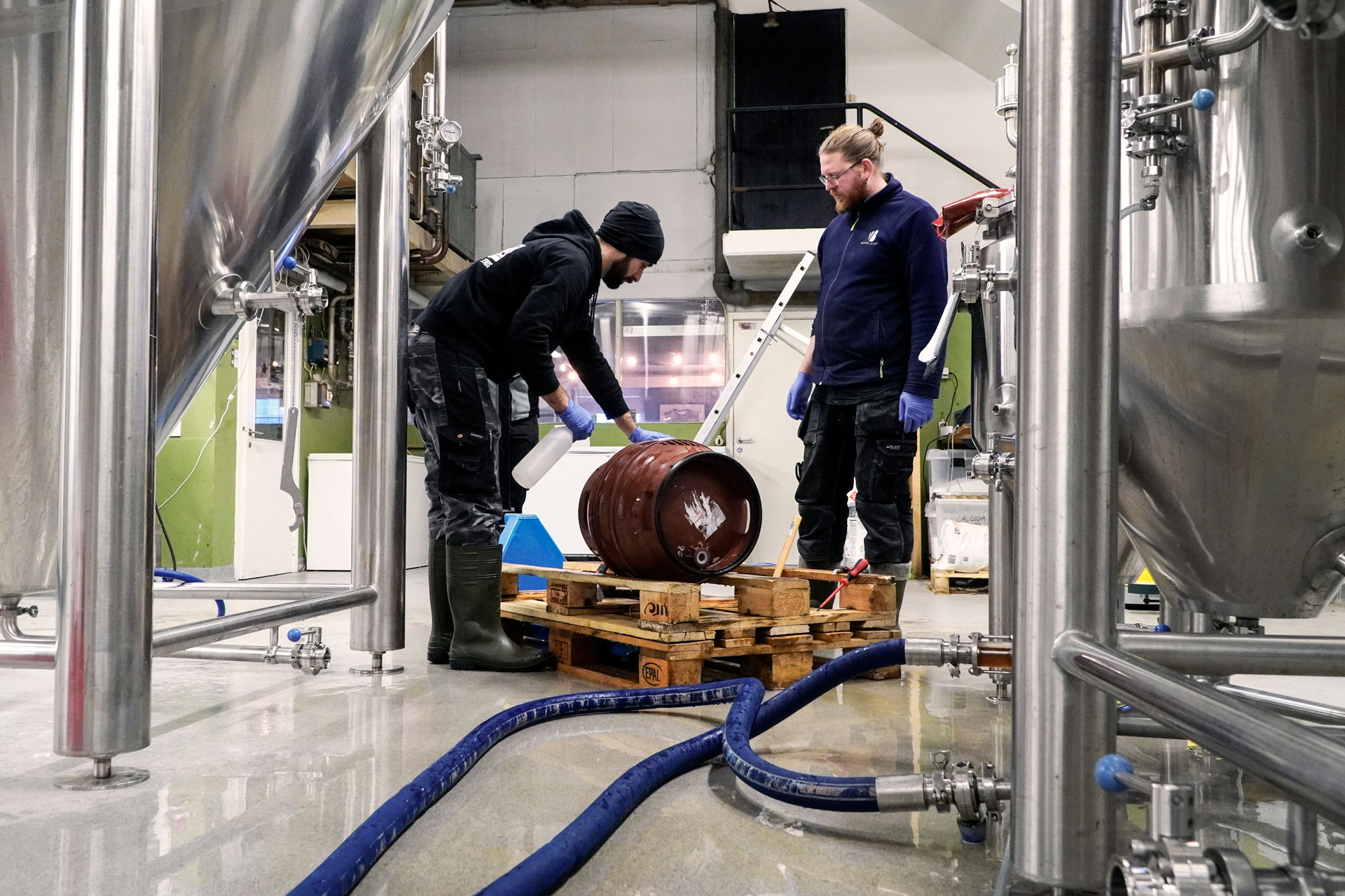 Our bOur brewers, Riccardo and Axel, filling casks with Malt Beverage, an Amber Lager, brewed by Swedish Craft Brewery Beerbliotek.ewers filling casks with Malt Beverage, an Amber Lager, brewed by Swedish Craft Brewery Beerbliotek.