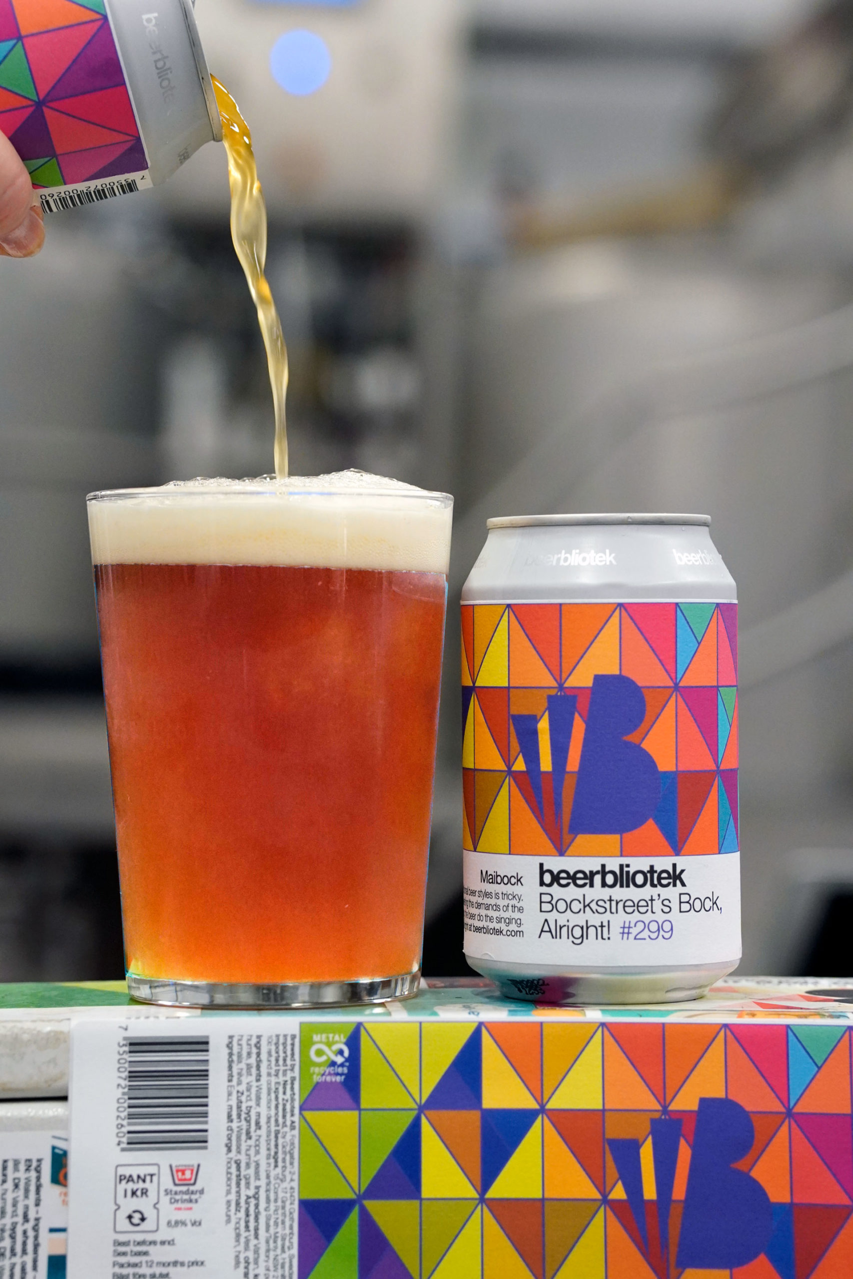 A can of Bockstreet's Bock, Alright! A Maibock, being poured into a glass, during the packaging day. This beer was brewed in Gothenburg, by Swedish Craft Brewery Beerbliotek.