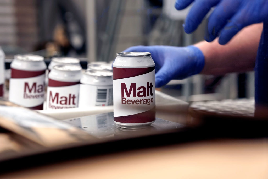 Malt Beverage, an Amber Lager, getting labels on during packaging day. This beer was brewed by Swedish Craft Brewery Beerbliotek.