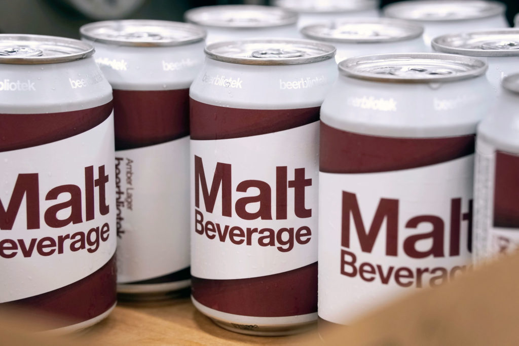 Cans in a box during packaging day of Malt Beverage, an Amber Lager, brewed by Swedish Craft Brewery Beerbliotek.