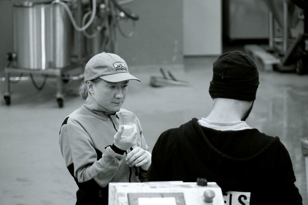 Linda Bengtström, tasting beers during the brewing process at Beerbliotek, a Swedish Craft Beer Brewery in Gothenburg.