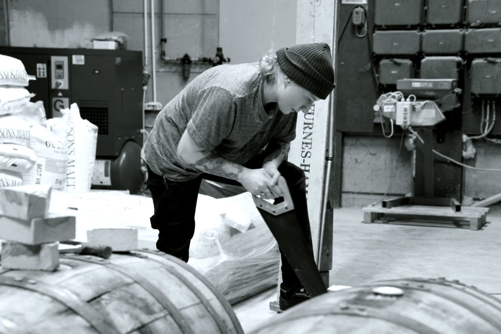 Linda Bengtström, working at Beerbliotek, a Swedish Craft Beer Brewery in Gothenburg. Cutting wood for a Barrel Aging project.