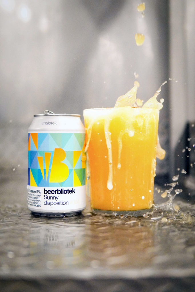 A tasting photo of, Sunny disposition, a New England Session IPA, being poured into a glass during the packaging day. This beer was brewed in Gothenburg, by Swedish Craft Brewery Beerbliotek.