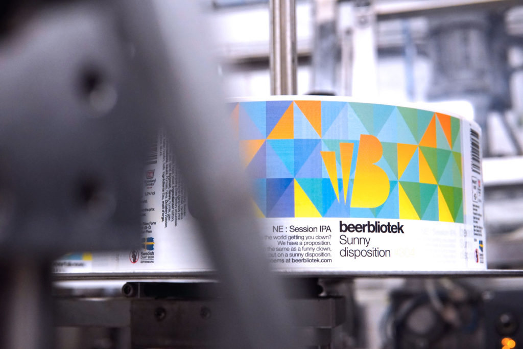 A label of Sunny disposition, a New England Session IPA, during packaging at Swedish Craft Brewery Beerbliotek.