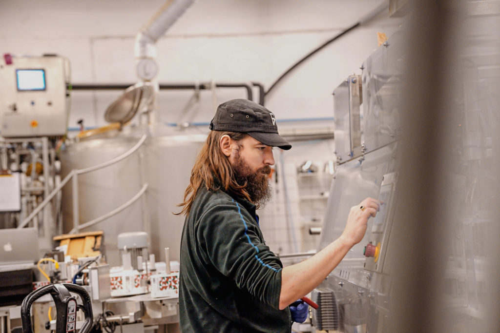 Jeremy Batt working on the canning line to package Amazing Maize, a Mexican Lager, at Swedish Craft Brewery Beerbliotek.